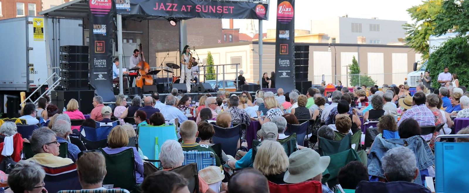A crowd watches a woman singer in Worcester at a Jazz at Sunset concert.