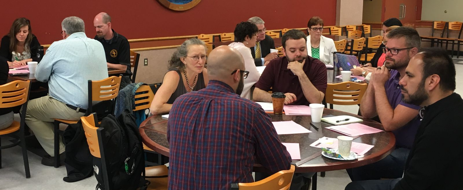 Holyoke teachers work in small groups in professional development.