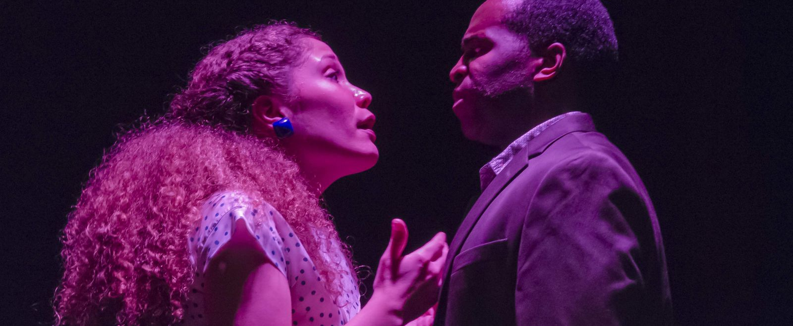 """A man and woman perform in a play called """"Lost Tempo"""" on stage."""
