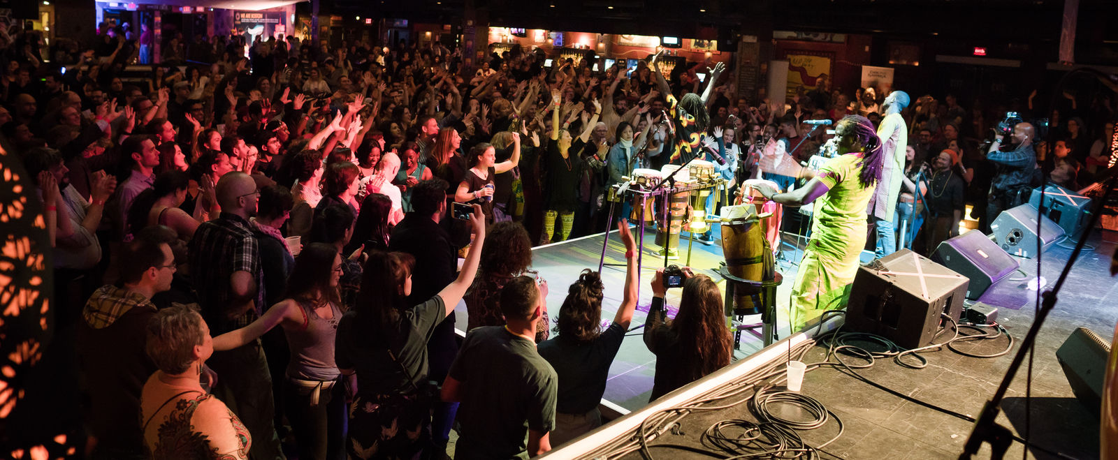 People dance at a concert.