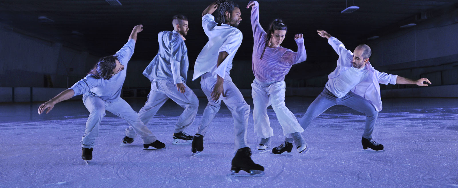 Men dance and ice skate.
