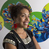 Artist Silvia Chavez poses with her mural.