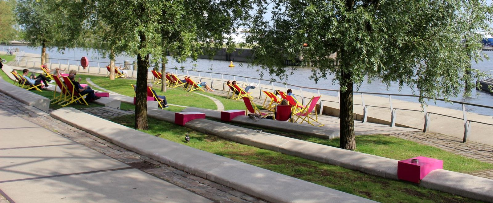 People relax and enjoy a resilient urban beach.