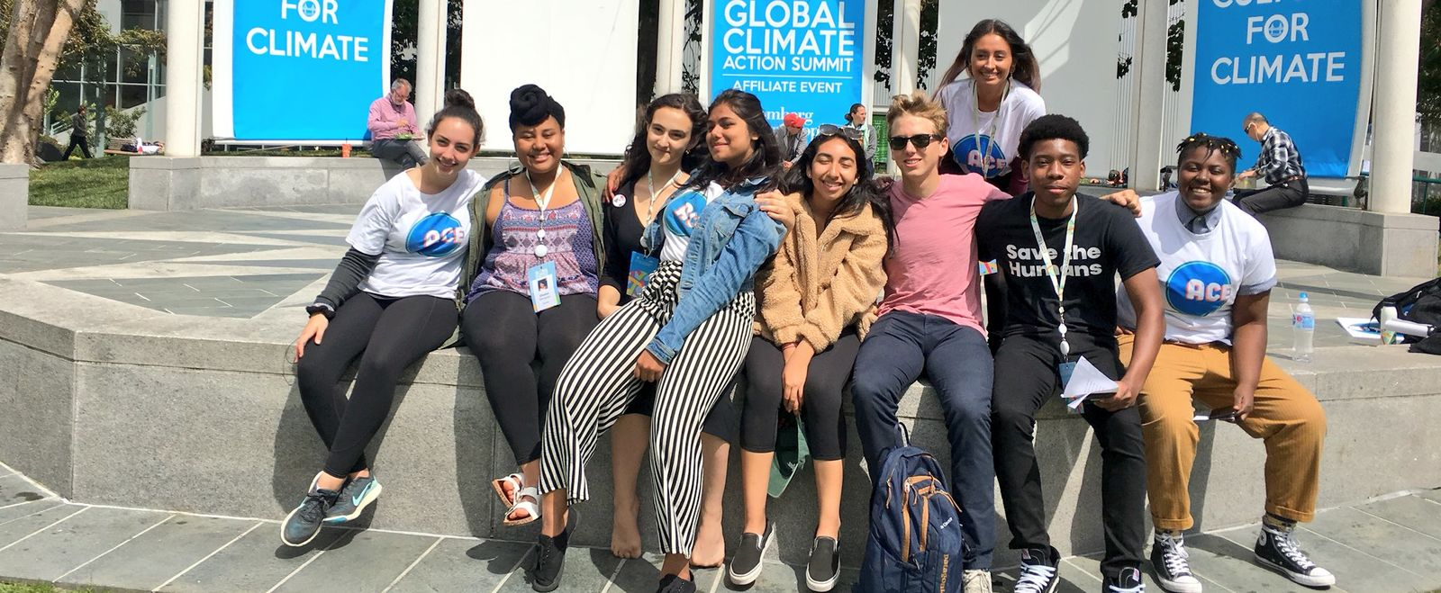 Teen speakers at the global climate action summit gather for a photo.