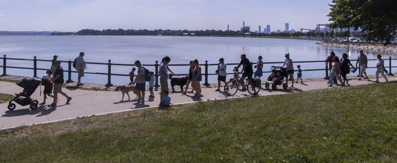 People walk and bike along Boston's waterfront.