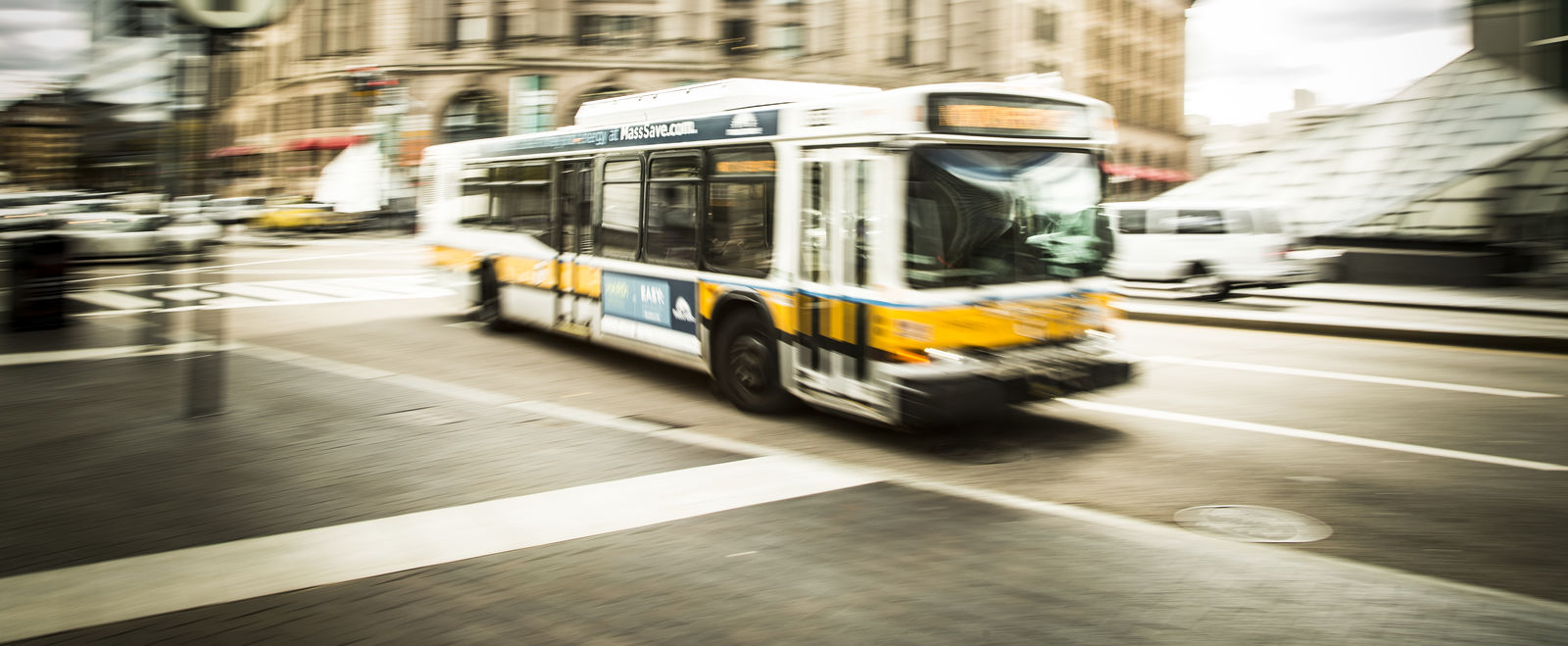 A bus speeds by South Station in Boston.