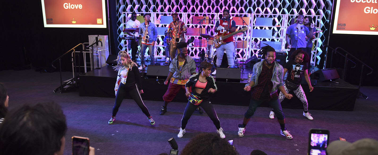 A group of young people dance on stage.