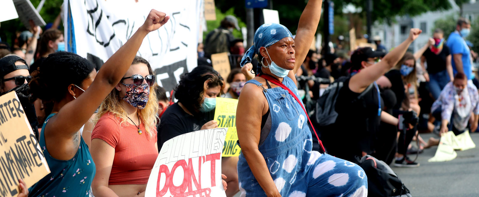 A woman raises her first at a rally for racial justice