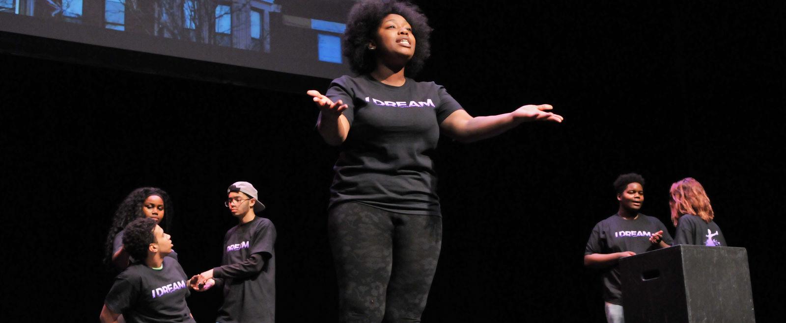 A woman speaks on stage.