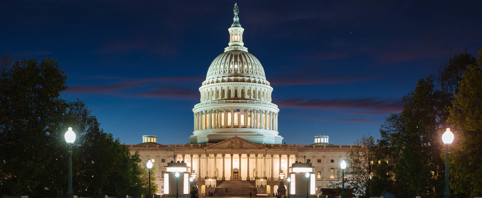 The D.C. Capitol Building at night time.