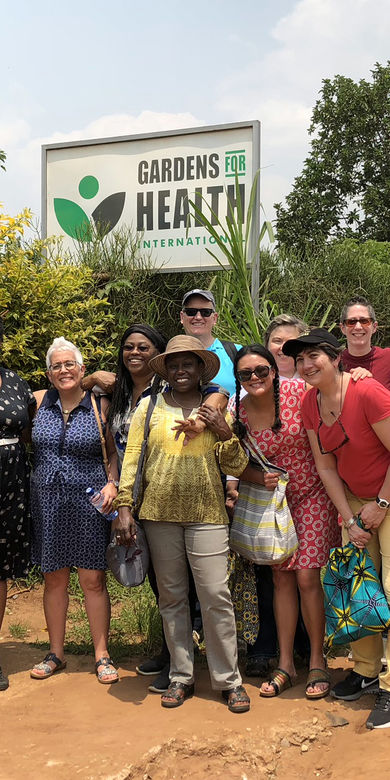 Barr Fellows posing in front of a garden
