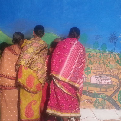Residents of Odisha,India painting the wall as part of the SDROI project.