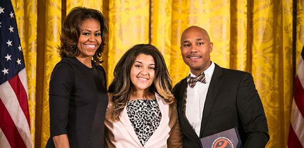Michelle Obama presents award to BCC Executive Director David C. Howse and chorus member Amber Rodriguez.