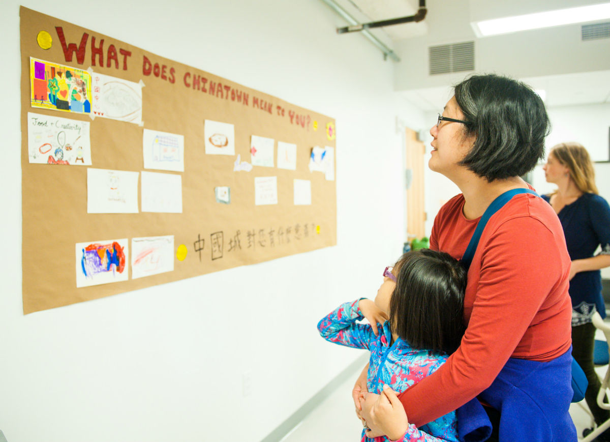Mother and child looking at BCNC poster, artwork