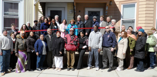 Completion of weatherization project Chelsea MA (photo courtesy of Green Justice Coalition)